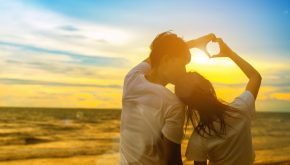 Young man and girl couple romantic dancing love leisure in celebration before married happy and fun at beach sunset vacation holidays, valentine day concept.